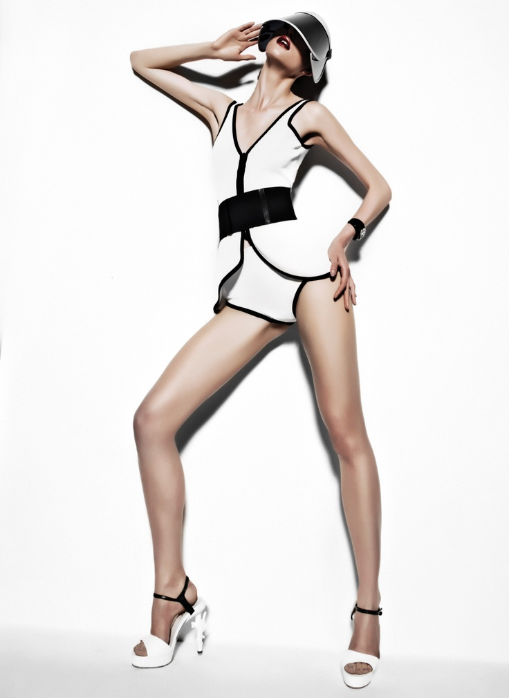 Laura Swimming costume, satin heels both CHANEL, elastic belt WOLFORD, bangle SALVATORE FERRAGAMO