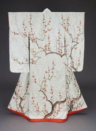 19th century (Edo Period) silk kimono (furisode) with a design of plum tree branches in red, pink, green, brown and white silk embroidery on a white silk damask with chrysanthemum and tortoiseshell pattern (William Sturgis Bigelow Collection)