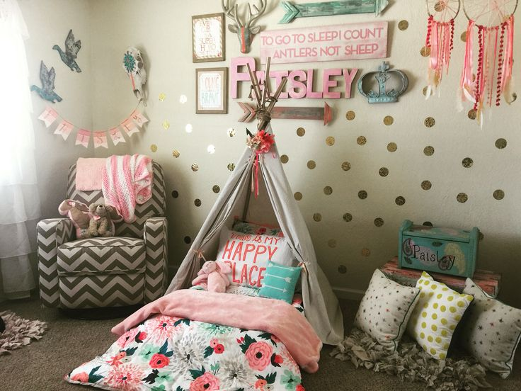 Wild and free toddler room. Tee pee Montessori bed on the floor.