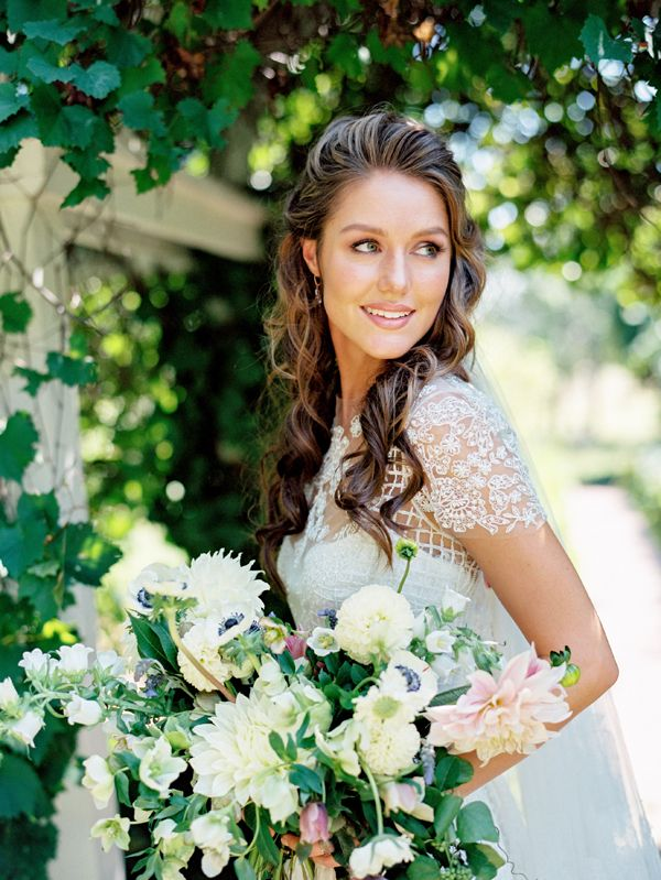 Fresh and pretty wedding hairstyle and makeup on this gorgeous bride