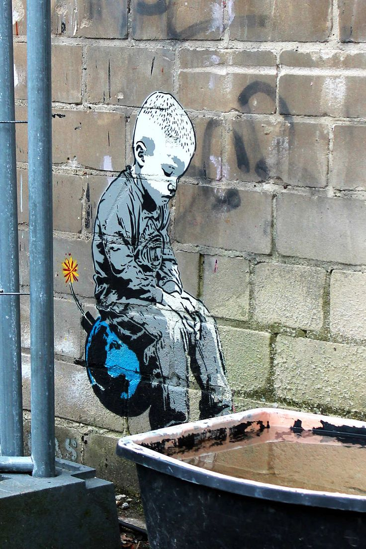 Boy on Bomb by Berlin based stencil Street Artist Alias