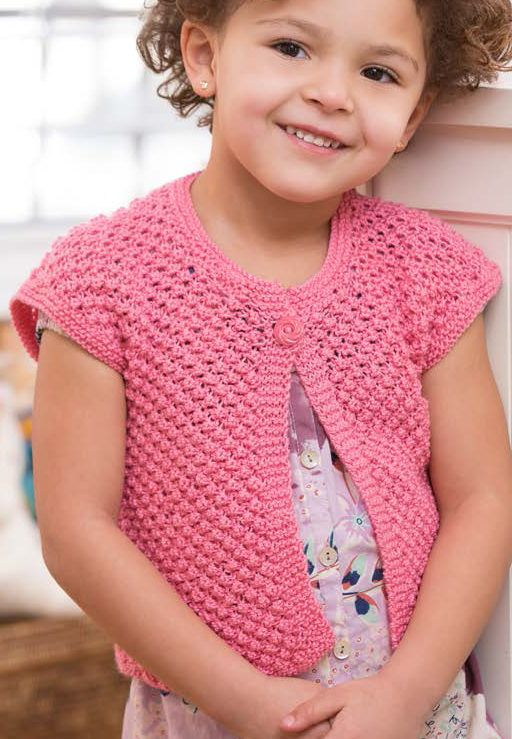 Free Knitting Pattern for Easy 4-Row Repeat Little Girl Shrug -This easy child's cardigan is knit in a 4-row repeat trinity stitch. Sizes 2, 4, 6, 8 years. Designed by Cathy Payson for Red Heart