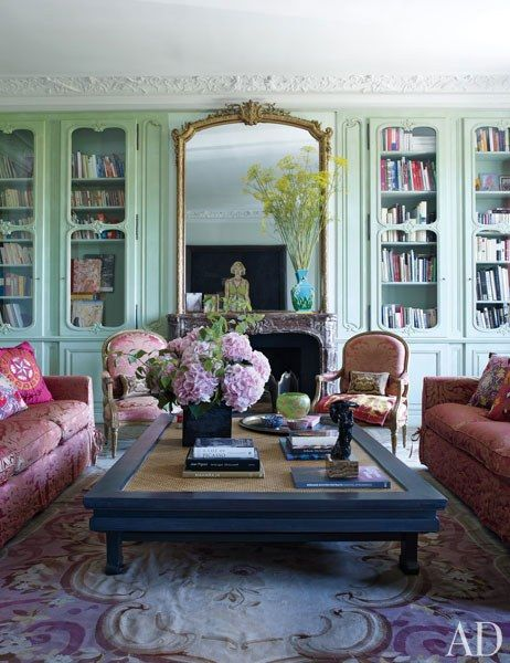 The heirloom Louis XVI chairs and the sofas in the living room are covered in a Rubelli damask from Donghia | archdigest.com