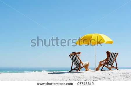 Couple On Deck Chairs On Beach Stock Photos, Images, & Pictures | Shutterstock