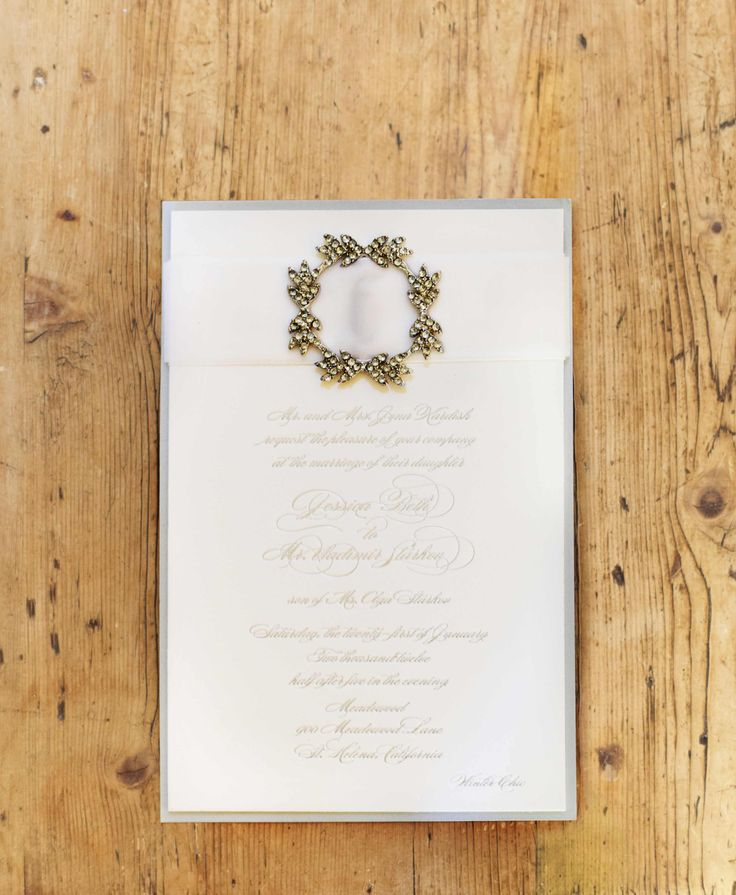 """The couple's metallic wedding invitation set the tone for their """"woodsy winter"""" theme. #weddinginvitation #weddingstationery Photography: Cooper Carras Photography. Read More: http://www.insideweddings.com/weddings/classic-winter-white-wedding-in-wine-country/417/"""