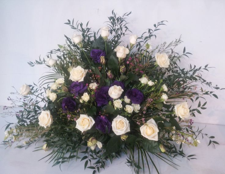 Altar arrangement with white Roses and purple Lisianthus. Wild and natural