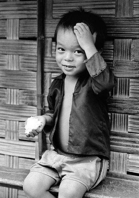 A Laotian refugee child at the Ban Nam Yao camp, Nan Province, Thailand. There are 2 camps in Nan: Sobtuang camp (10,427 refugees) and Ban Nam Yao camp (13,366 refugees). Living in these camps are refugees from Laos who have fled to Thailand since 1975. These Laotian refugees are from 5 major tribes: Hmong (or Meo), Yao , Phai (or Thin), Lao, and Khmu.  Photo ID 101360. 01/07/1979. Thailand. UN Photo/John Isaac. www.unmultimedia.org/photo/