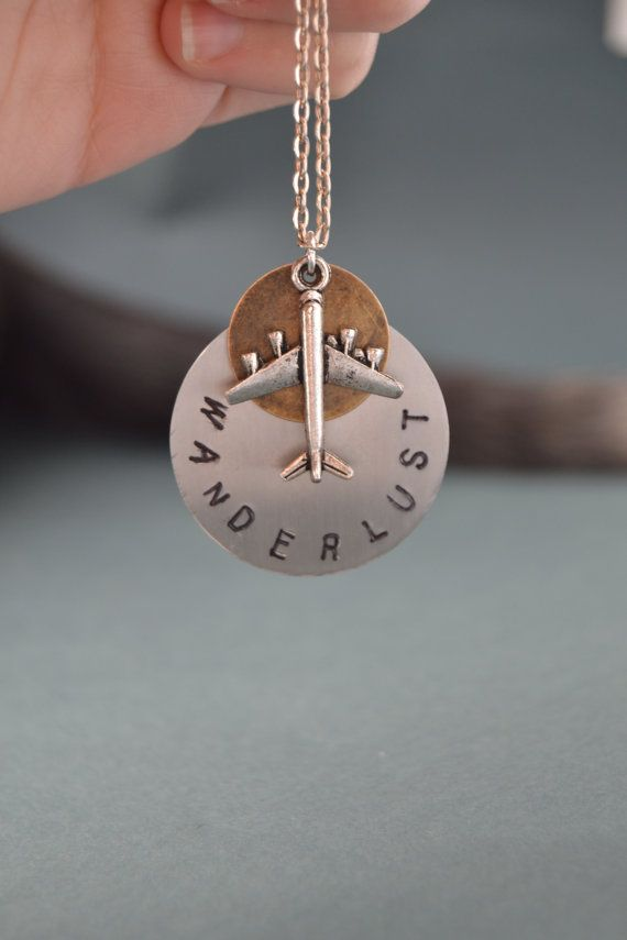 I´ll be restocking this beauty soon. Stay tuned! ^_^  Hand stamped steel and brass discs Wanderlust necklace - Airplane necklace - Wanderlust jewelry - Unisex - Gift for traveler Travel jewelry by Valkyrie´s Song
