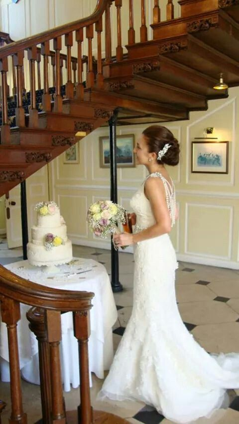 Before cutting the cake at Gosfield Hall by the beautiful stairs