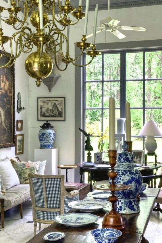 Furlow Gatewood Who else spots the ceiling fan? Also, the lamp on a stand? Two interesting elements in this wonderful blue and white Ch...