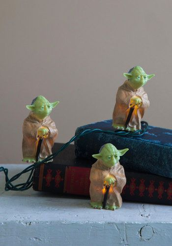 In the dark about how to decorate for your next geeky get-together? Brighten up your pad with these Yoda-shaped string lights...