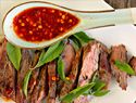 Spicy grilled skirt steak with Thai red chili sauce