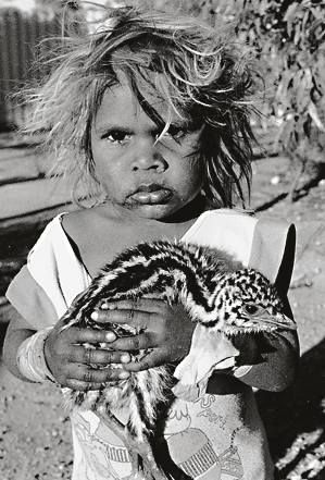 Australian Emu Chick held by Aboriginal Girl ~ Photography by Aliastair McNaughton