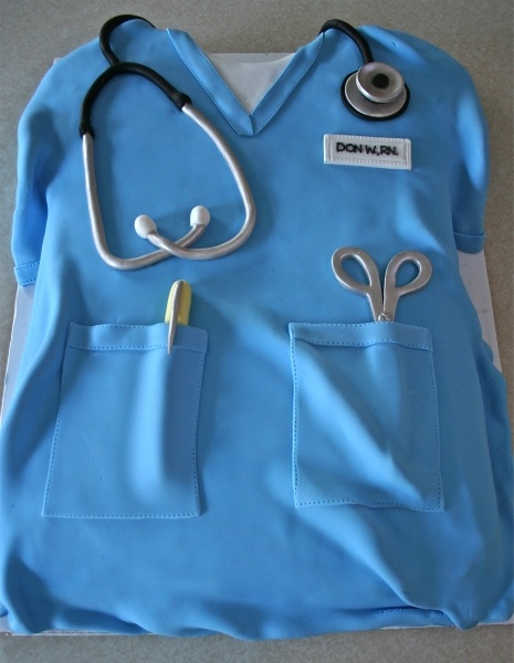 Blue scrubs shirt with scissors, pen and stethoscope made of sugar