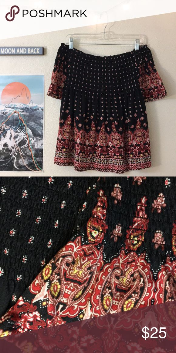 Off the shoulder blouse Never worn before!  Off the shoulder black, red, pink, and white patterned blouse. Cinched around the chest with cute flowing sleeves! Tops Blouses