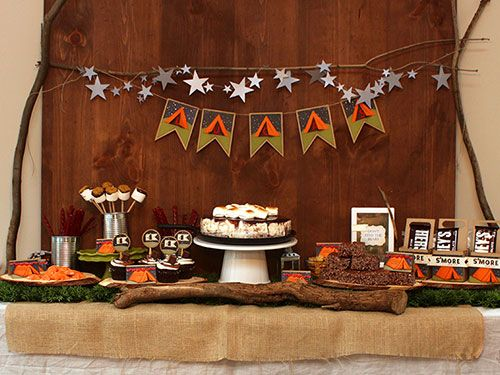 DIY Camping Trip Made Easy: Forget the tents and bugs, create your own camp out experience with a homemade s'mores bar with all the fixings.  Complete your party with paper star decorations to mimic the night sky.