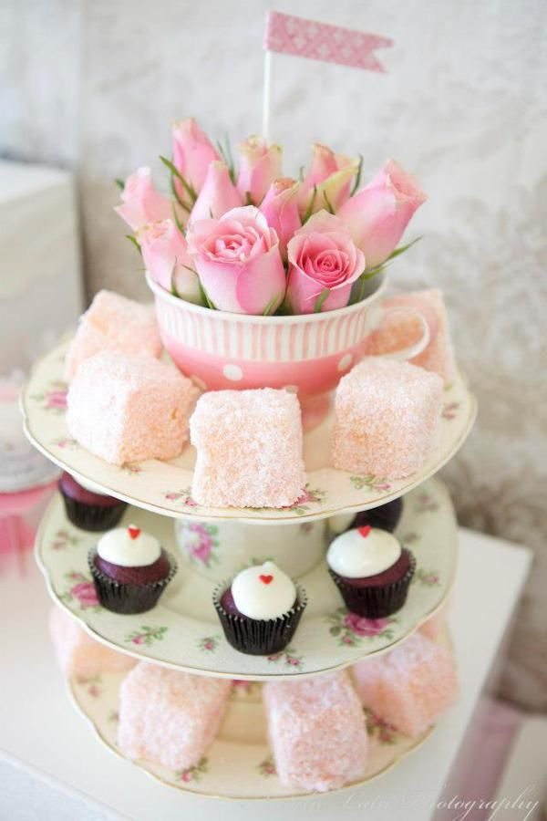 Beautiful centerpiece made using Cups, Saucers, Flowers and individual sweet treats http://www.karaspartyideas.com/2013/02/ladies-vintage-high-tea.html