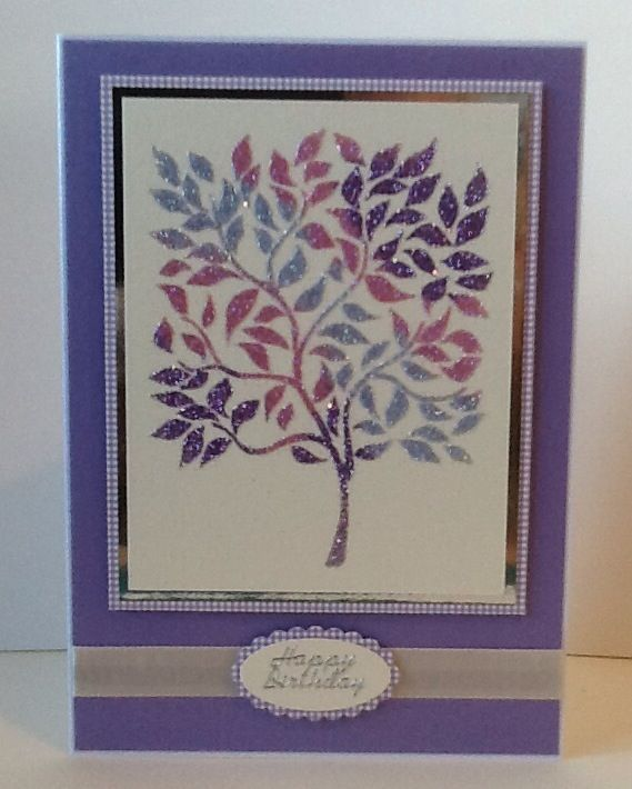 Card using Sweet Poppy pear tree stencil with various lilac, pink and pale blue glitters.