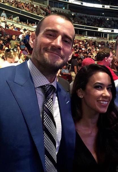 Cm punk and AJ lee look so perfect next to each other