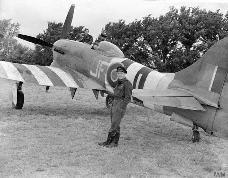 Wing Commander R P Beaumont, wing leader of No. 150 Wing, leaning against a Hawker Tempest Mark V of No. 3 Squadron RAF at Newchurch Advanced Landing Ground, Kent.