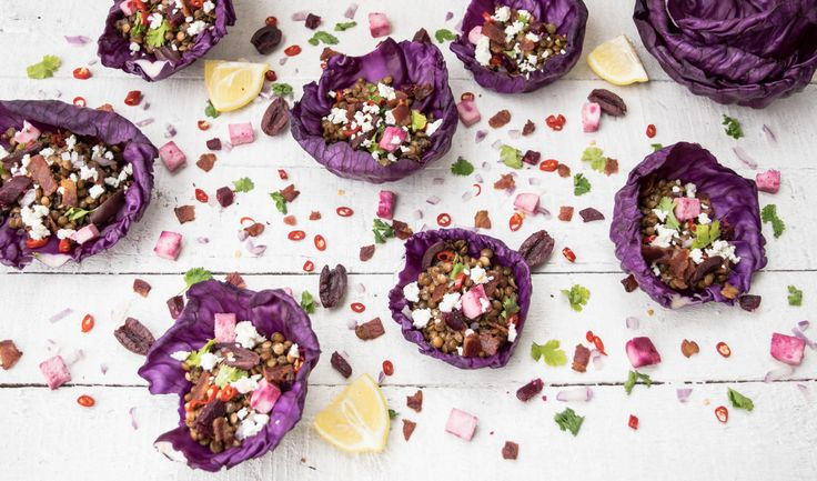 Lentil Salad with feta, olives, red chilies, bacon and poached duck egg. Also a vegetarian version with paneer cheese and beetroot. Served in red cabbage cups.