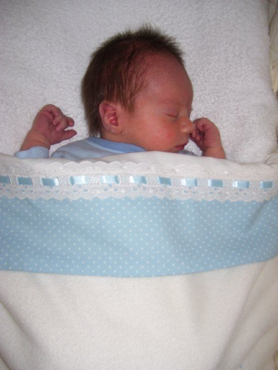 Ezekiel sleeping peacefully in the bassinet sheets I made for him