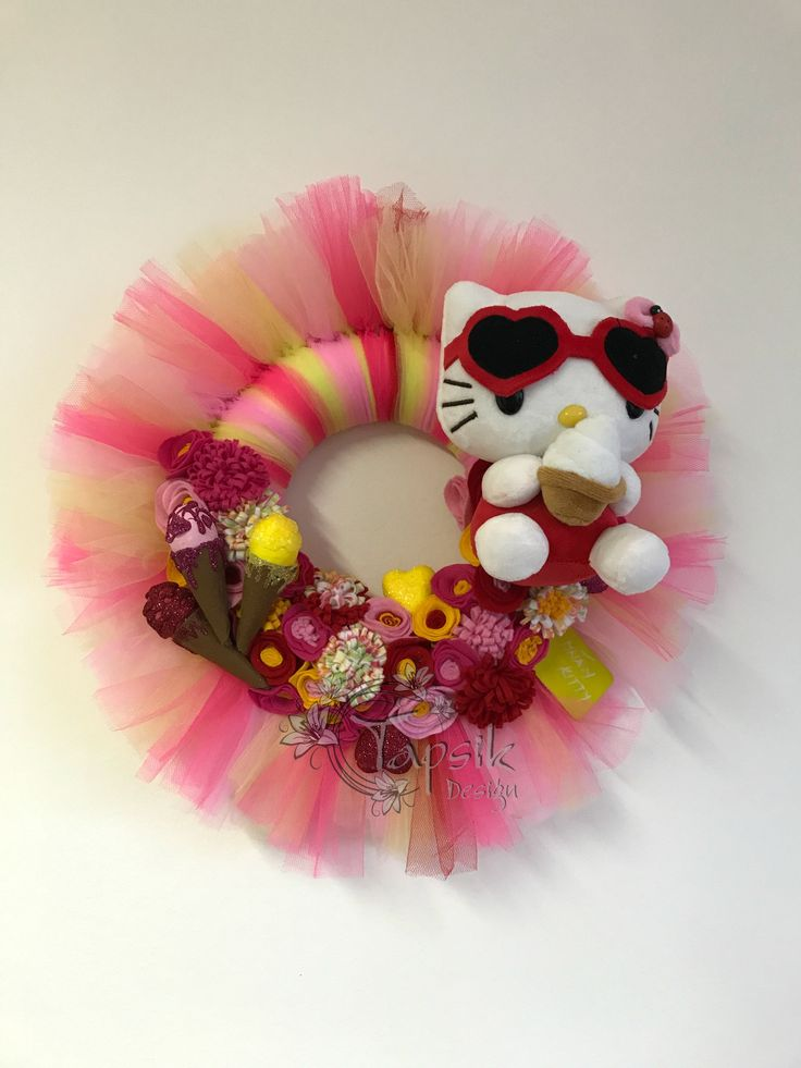 Hello Kitty Wreath, Giveaway. So first wreath from my Kitty giveaway is done. Sweet-tooth Kitty. Base styrofoam wreath. Next added different color of tulle. Handmade felt flowers and handmade ice-cream with cones and hand decorated hearts and board. You can write on that board. And of course Kitty. Around 45 cm.