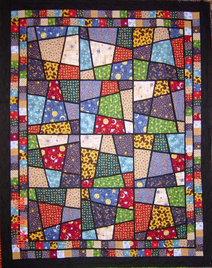 "I have made several Magic Tile quilts.  I use freezer paper to plan my block.  2 cut lines top to bottom and 2 cut lines side to side and using 9 different pieces of fabric 15 to 16 inches square.  1 fabric for ""grout"" lines cut 1"" wide.  Results are fun and amazing as you cut and shuffle as you go."