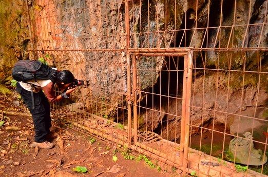 Take a picture: A replica of Manusia Pawon is placed in Pawon Cave since 2006. Visitors are free to take pictures from o...
