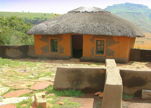 Traditional Basotho Hut with painted decoration on exterior walls by Nostalgic T+ Allan, via Flickr