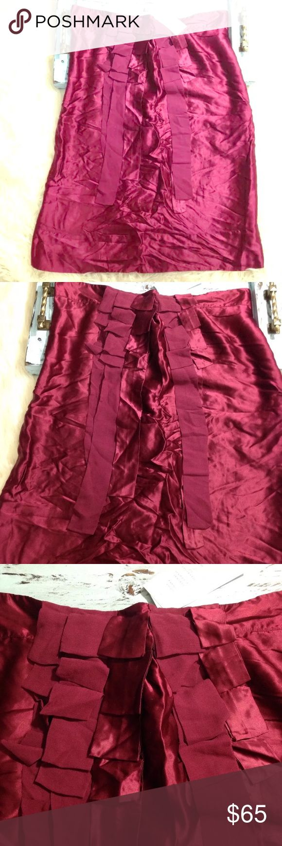 NEW French Connection 100% Silk Skirt Maroon NWT New with Tags French Connection 100% silk maroon knee length skirt in a size 10.  Beautiful detail on front of skirt.  Super comfortable and cute!! French Connection Skirts