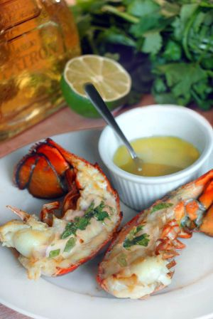Lobsters grilled tails with tequila marinade recipe Makes 8 split lobster tails, serves about 3 or 4 Four 1 lb frozen lobster tails (found in most supermarkets or membership stores) 2 tablespoons melted butter 1/4 cup chopped fresh cilantro leaves 1/2 teaspoon of minced roasted garlic 1/2 lime squeezed for juice
