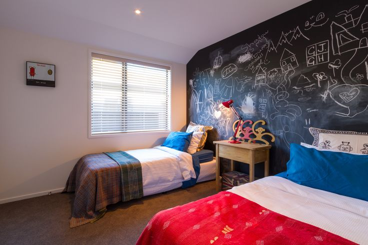 Children's room with chalk board wall! How cool is this for the young ones, or giving the older ones an excuse to join in too!
