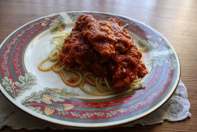 Slow cooker Chicken Parmesan: 2-4 boneless, skinless chicken breast halves   1/2 cup plain bread crumbs  1/2 cup grated Parmesan cheese  1 tsp. Italian seasoning  1/4 tsp. ground black pepper  1/4 tsp. kosher salt  1 Tbs. olive oil  1 egg, beaten  4-6 slices mozzarella cheese  1 jar (28-ounces) favorite marinara sauce