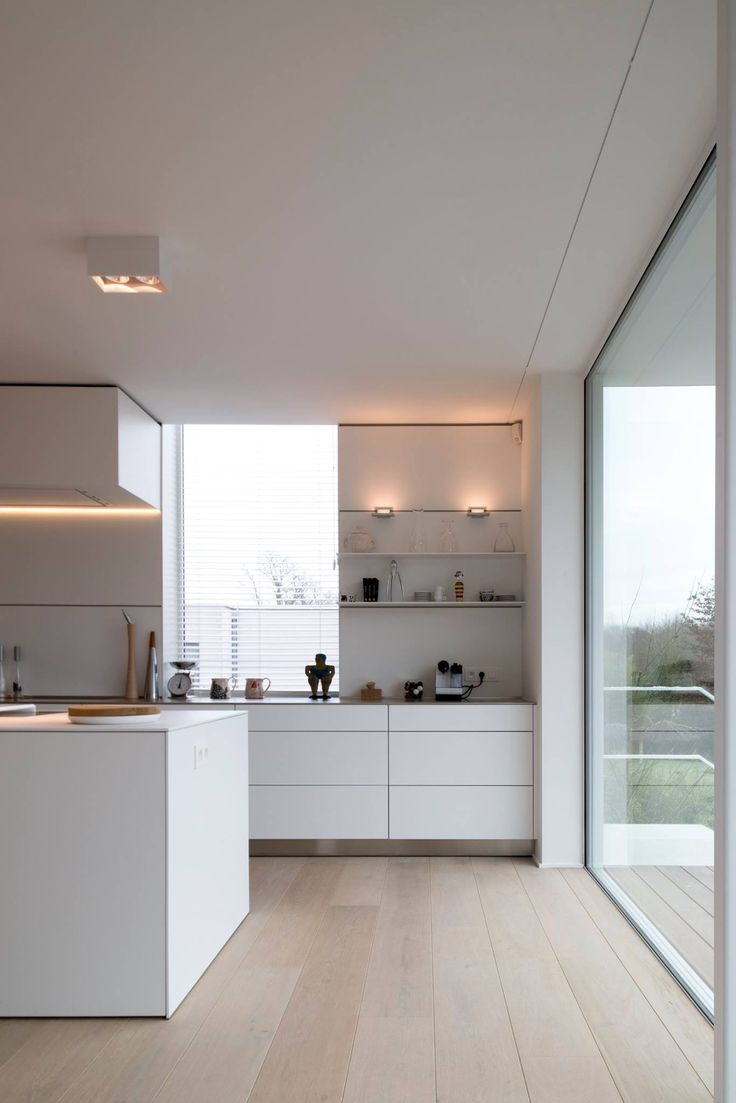Modern white kitchen, love the big window