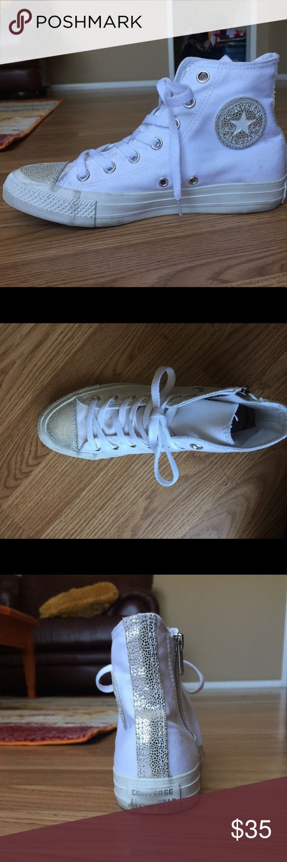 Silvery White Converse High Tops Converse High Top shoes in white with silver glittery toe and stripe on the back. New without tags. Never worn. Men's size 5. Women's size 7 or 7.5. Converse Shoes Sneakers