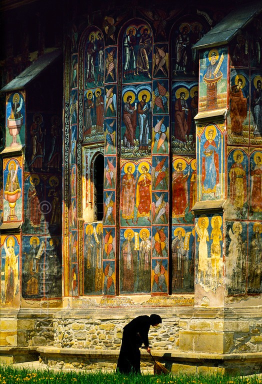 A nun at Moldovita Monastery, Romania. Petru Rareş, who ruled Moldavia, promoted a new vision for Bucovina churches. He commissioned artists to cover the int. and ext. with elaborate frescoes (portraits of saints and prophets, scenes from the life of Jesus). Seven of them--including the Monastery of Moldovița--were placed on UNESCO World Heritage list in 1993. www.romaniasfriends.com