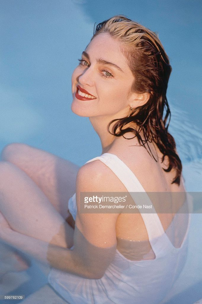 News Photo : Singer Madonna sitting in a swimming pool with...