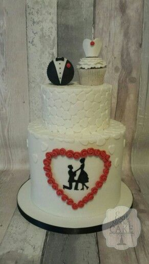 Hearts and silhouette wedding cake with cupcake toppers.