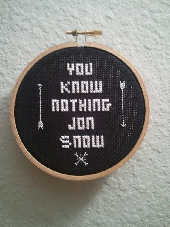 This finished cross stitch is approximately 4 inches across, black background with white floss on a wooden hoop.