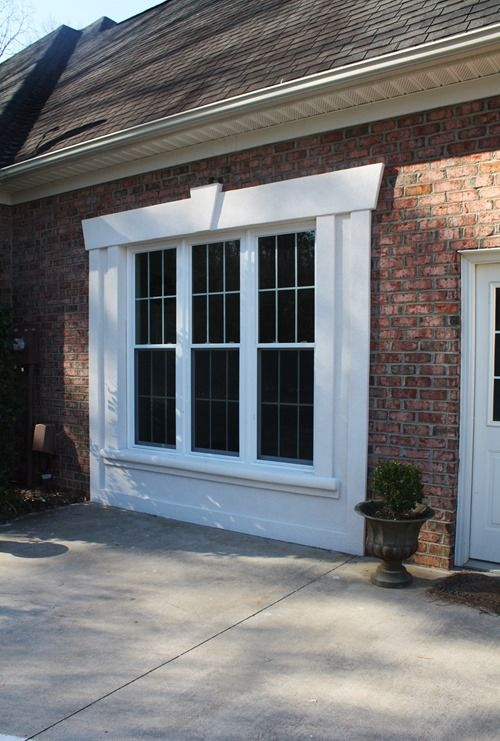 "Nice Window substitution for a garage door. The surround matches other windows on the house. Could add some ""portable"" landscaping in front of the window."