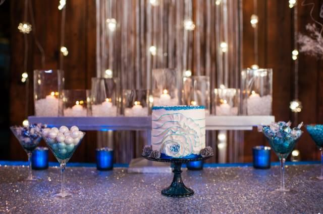 Be it a holiday party or a winter wedding, we are loving the Silver Sequin table linens with hints of frosted blues. Photograph by: Barrie Anne Photography