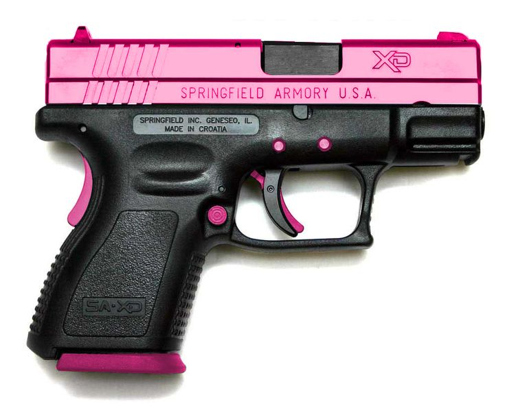 This one is nice.  Usually the grip is the pink part (it's a lot easier to make a pink polymer grip than it is to anodize or powder-coat the slide).  Nice.  It's a Springfield (manufacturer) XD-Series gun.  Not sure the caliber, but it is the sub-compact model with a 3-inch barrel. If only it was purple!!!