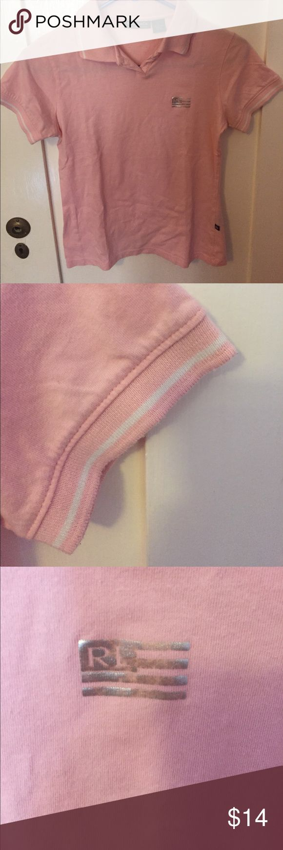 Light pink Ralph Lauren polo shirt. The flag on the front of the shirt is a little worn out and fading. I will iron the shirt before shipping. Ralph Lauren Tops Blouses