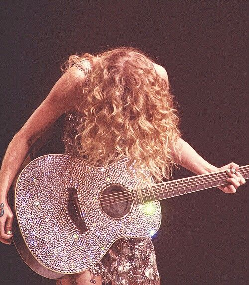 I miss her sparkly dresses and guitar.