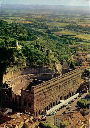 Orange: Théâtre Antique| a Roman theatre in Orange, France, built early in the 1st century AD. The home of the summer opera festival, the Chorégies d'Orange. | Learn more about the beautiful places in France by checking out the Travel section of Talkinfrench.com https://www.talkinfrench.com/tag/french-tourism/