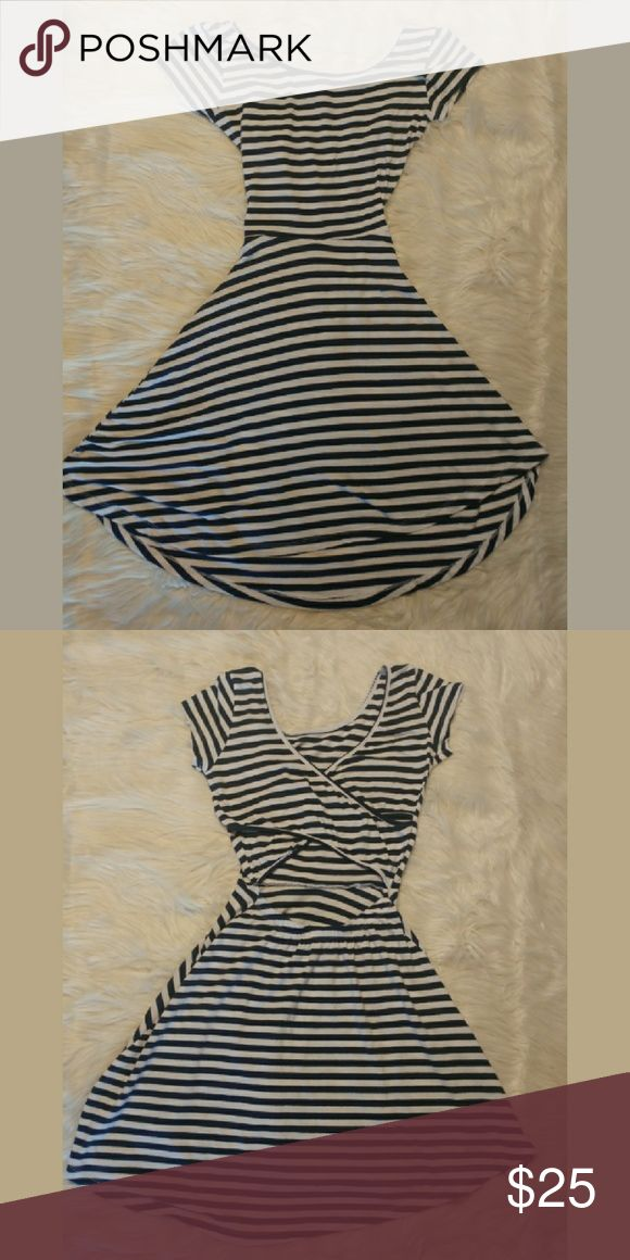 Cotton On Striped Criss-cross Back Skater Dress The nautical navy blue stripes and criss-cross back cut out make this A-line dress a fashion go to for a beach side  cover up or a casual, but flirty sun dress. Cotton On Dresses Mini