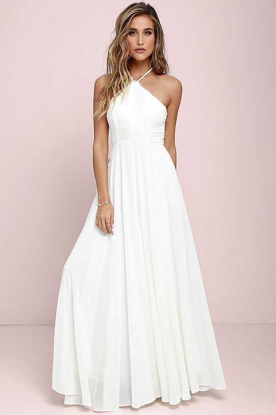The Everlasting Enchantment Ivory Maxi Dress will have admirers under your spell! Adjustable spaghetti straps support a lacy halter bodice, then crisscross at back. Layers of chiffon sprout from a fitted waist, then sweep down to an elegant maxi length. Hidden back zipper with clasp.