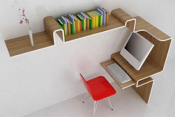 En ook dit grafisch ontwerp toont dat het soms heel simpel kan. Door de werkruimte te laten doorlopen in een boekenplank, creëerde de ontwerper niet alleen een min of meer geborgen werkplek, maar ook veel extra opbergruimte.