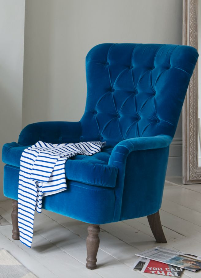 The button back Hound Dog armchair is a true classic and the perfect reading chair. Handmade in Britain, it comes with solid oak upholstered legs. Upholstered here in Teal plush velvet and available in over 120 gorgeous fabrics.